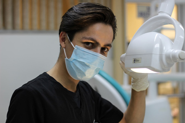 Dentist using equipment