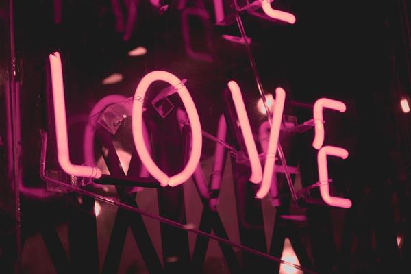 Pink neon sign spelling love