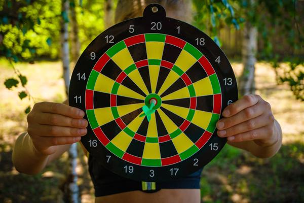Dartboard with the dart on the bullseye