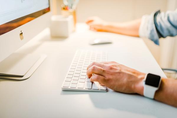 man setting up a webinar on laptop